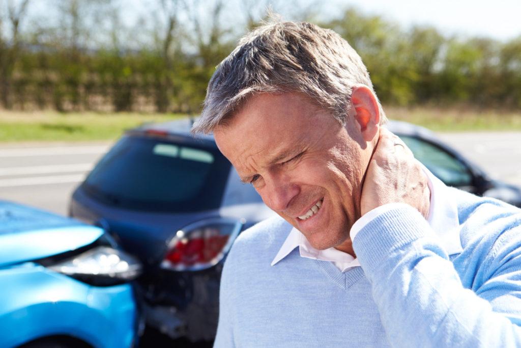 man with injured neck due to whiplash